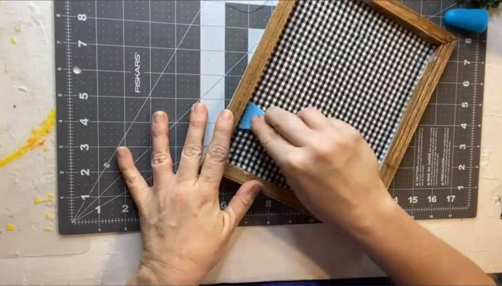 adding gingham fabric to the canvas
