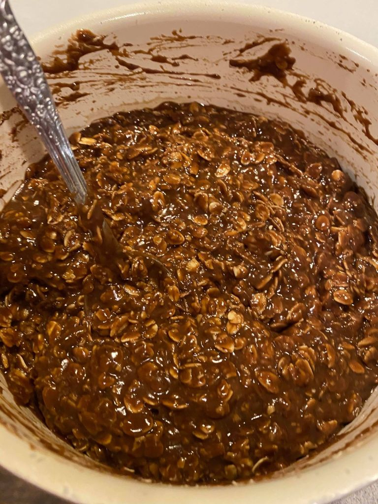 chocolate peanut butter oatmeal no bake cookie mixture in a pan
