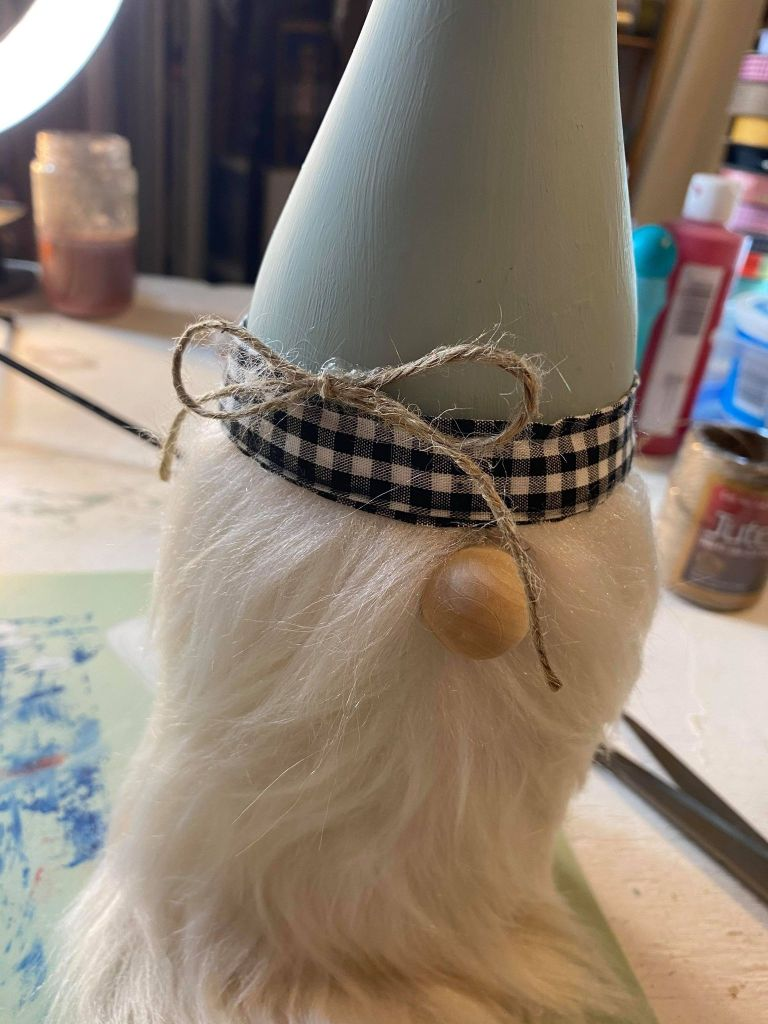 adding a twine bow detail to a farmhouse wine bottle gnome