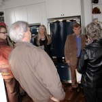 Mayor Mike Cooper, right, talks with members of the Jenkins family and other visitors in the kitchen.