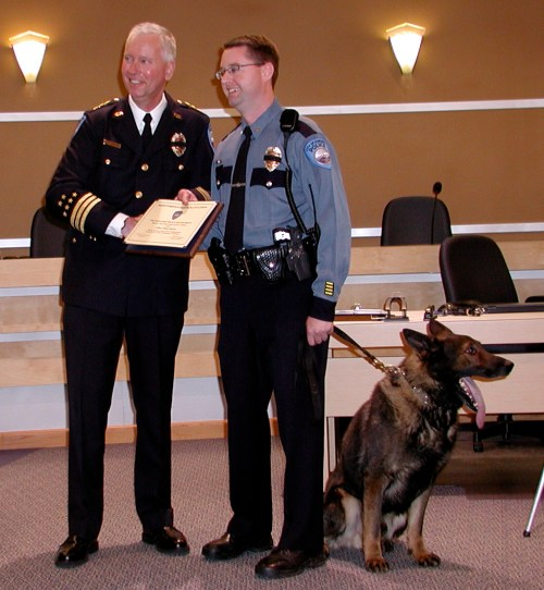 Police Chief Al Compaan presents Officer Shane Hawley and Rocky an award of valor in 2011.