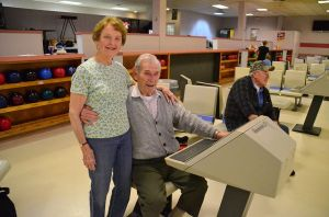 """Jack and Helen Peterson, married 62 years, have been regular bowlers at Robin Hood for decades. An avid bowler for many years, Jack's knee injuries now keep him out of the game. """"But I still show up to cheer everyone on,"""" he says. """"I'm Helen's biggest fan."""""""