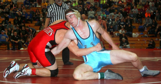 Meadowdale's Tim Smith (right) edged Glacier Peak's Noah Palmaffy 3-0 in the 220-pound finals.