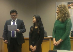 Alderwood Middle student Mia Nguyen, center, and principal Erin Murphy listen as a representative of Prudential Financial announces her award.