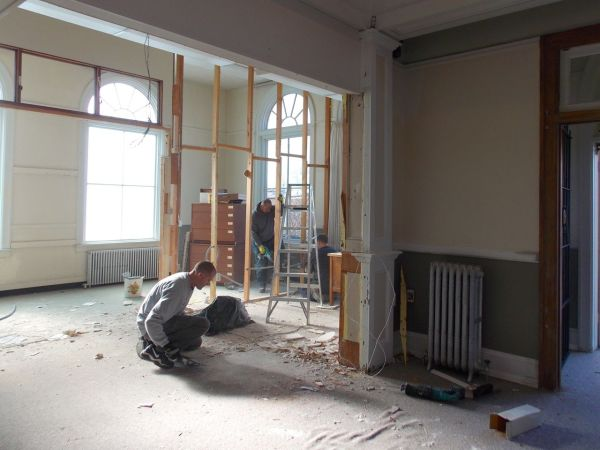 As part of the renovation, workers tore down walls and restored woodwork and floors.