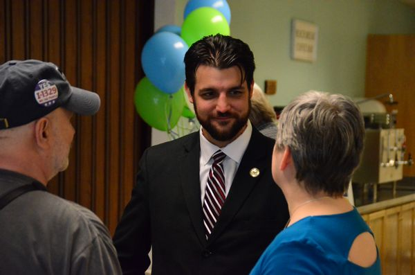 Justin McMahon with supporters at the conclusion of his Thursday evening campaign kickoff event.