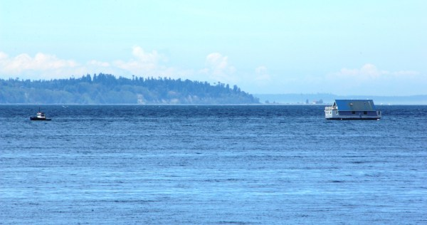 Seen by Tom Dockins from the Edmonds waterfront Wednesday: A  tug boat towing a small house south on Puget Sound.