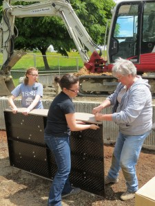 Volunteers, from right, putting together play equipment Friday included church missionaries, from left, Sister Madsen and Sister Franzen and Edmonds resident Dana Nielsen.