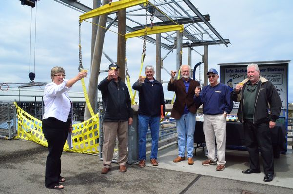 Mayor Dave Earling joined officials from the Port of Edmonds and others to toast the opening of the renovated boat launch at the Edmonds Marina.  From left, Port Deputy Director Marla Kempf, Deller, Port of Edmonds Executive Director Bob McChesney, Earling, Port of Edmonds Commission President Jim Orvis and Port Commissioner Fred Gouge.
