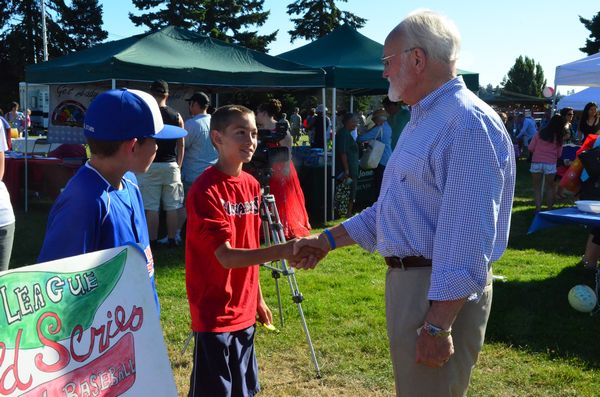 "Mayor Dave Earling stopped by to chat with members of the U11 Pacific Little League All-Star team, who was there to assist in fundraising for the U12 team that is bound for the Little League Regional Tourney in San Bernardino Wednesday. The mayor even bought an ""I Believe"" bracelet."