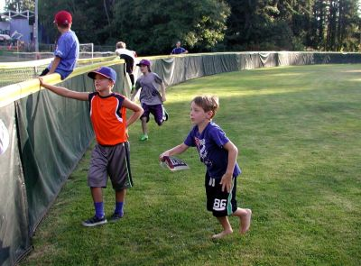 Boys rush to see members of the Pacific Little League All-Stars arrive at Lynndale Park.