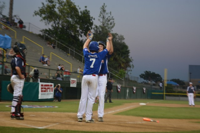 Pacific Little League's Ian Michael congratulates Karsten Tjarneberg after his 2-run home run in the sixth inning against Montana.