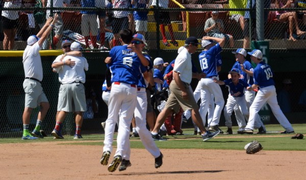 Pacific Little League players celebrate beating Oregon 6-3 in the Northwest Regional title game to earn a trip to the Little League World Series. (Photos by Joe Michael)
