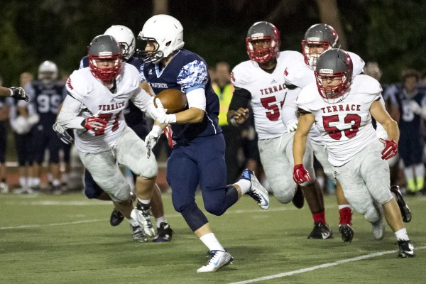 Meadowdale running back Rory Spillum makes yardage against the Mountlake Terrace defensive line.