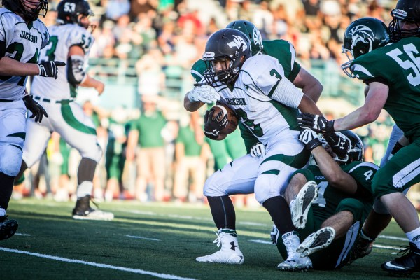 Warriors converge to stop Jackson running back Andrew Cho Friday night.