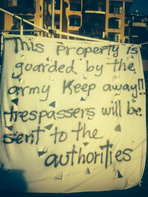 Resort staff wrote this warning to deter looters from coming on to the property.