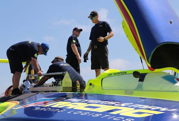This Peters and May crew preparing the boat Thursday for this weekend's racing. (Photo by Chris Denslow)