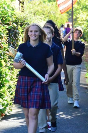 School commissioner and student council president Brooklyn Fahey leads the student procession to their seats.  Fahey is the daughter of former Edmonds Mayor Barb Fahey.