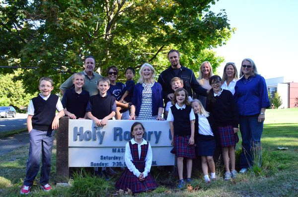 Over the past 50 years Holy Rosary School has educated several generations of Edmonds residents.  Here principal Sue Venable joins a group of Holy Rosary alums whose children now attend the school.