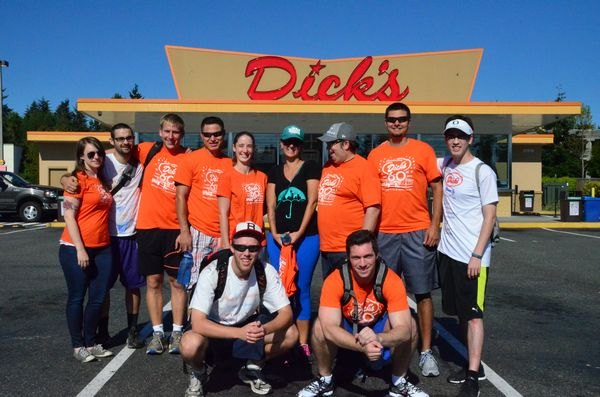 Walkathon participants pose in front the Edmonds Dick's Drive-in on Highway 99.  Front row, event organizers JP Osseward and Lars Phillips.  Back row L to R: Kimmy Manson, Zack Gussn, Chris Kaimmer, Jose' Hernandez, Lily Hernandez, Tara Pauw, Aaron Morse, Keyan Hanson, Kevin Drake.