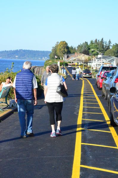 """The newly striped walkway on Sunset Avenue drew quite a crowd on Saturday afternoon, as temperatures hit the high 70's under sunny skies.  As the photo shows, pedestrians are making good use of the wider, level walkway and taking in the views that on Saturday included an unobstructed panorama from Mt. Baker to Kingston.  """"The view is great, no more competing with cars, and no more twisted ankles,"""" exclaimed one passerby. """"They should have done this years ago!"""""""