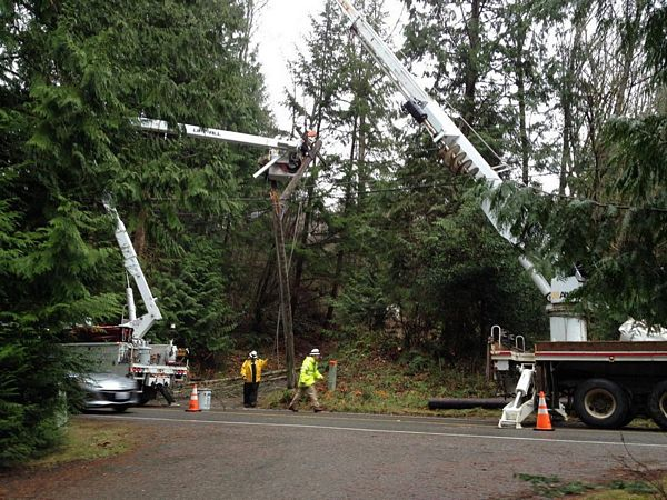 Utility crews repair a broken power pole in the wake of December's windstorm. (Photo courtesy Snohomish County PUD)