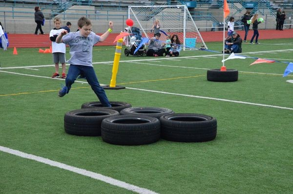 A boy enjoys the tire obstacle course at the 2014 Health and Fitness Expo. (Photo by Larry Vogel)