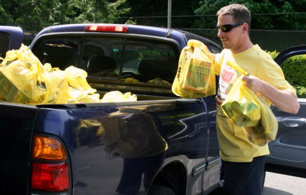 Mail carrier Ken Johnson collected a truckload of food donations.