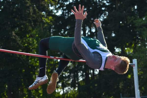 """E-W's Grant Whitcutt takes 1st in the high jump at 6' 4""""."""