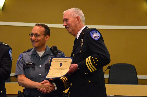 Officer Jason Shier is recognized for his quick thinking and decisive action in saving an infant who was being swung about in a baby carrier by its mentally distressed mother.
