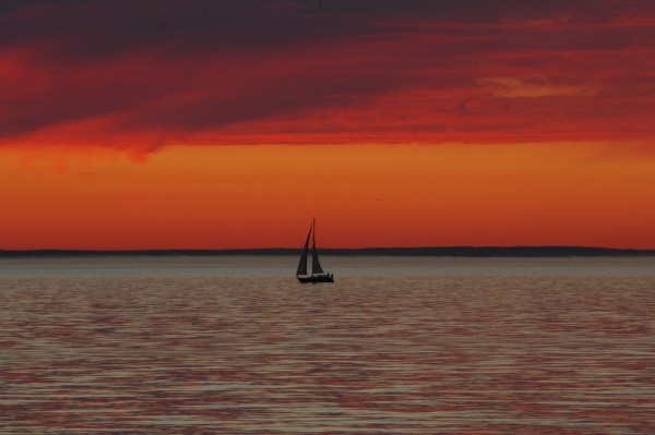 A sailboat silhouetted in Saturday's sunset. (Photo by Tom Dockins)