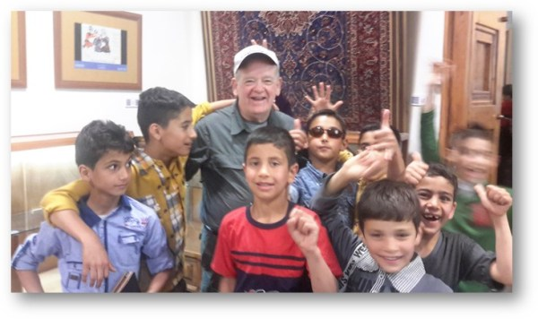 Mike Meeks visits with Iranian children.