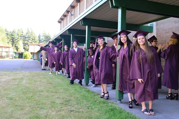 Nervous seniors line up outside the gymnasium preparing for the ceremony.