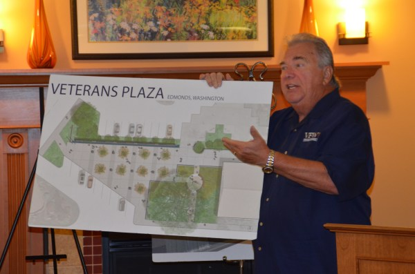 "Edmonds Veterans Plaza Chair Ron Clyborne, a Marine Corps Vietnam veteran and Edmonds real estate agent, provided an update on the plaza project for those attending Wednesday's Edmonds Chamber of Commerce networking breakfast. The goal is to raise $450,000 to build a tribute to veterans outside the Public Safety Complex plaza. It will include a polished stone wall with individual areas for each of the five services, each separated by a series of miniature waterfalls. There will be matching stone seating pedestals and a small memorial garden honoring those who paid the ultimate sacrifice. ""This is going to be an incredible addition to the community,"" Clyborne said. ""It's going to be really beautiful."" Learn more at edmondsveteransplaza.com."