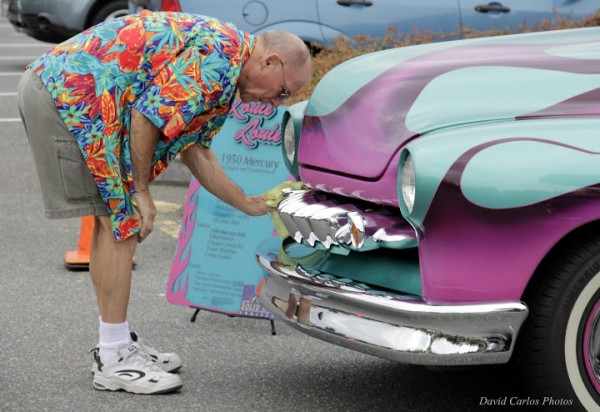 A proud owner polishes his 1950 Custom Mercury at the 7th annual Edmonds car show benefiting local charities, this year held in the Dick's Drive-In parking lot. (Photos by David Carlos)