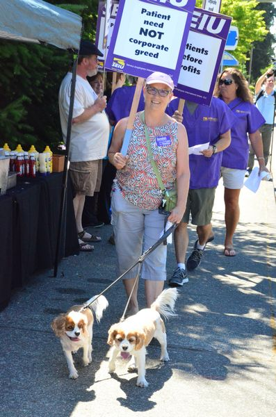 Denise Hartinger has worked as a nurse at Swedish Edmonds -- and Stevens Hospital before that -- for 40 years.  She took time from her day off to join the picket line with her dogs Dublin and Allie.