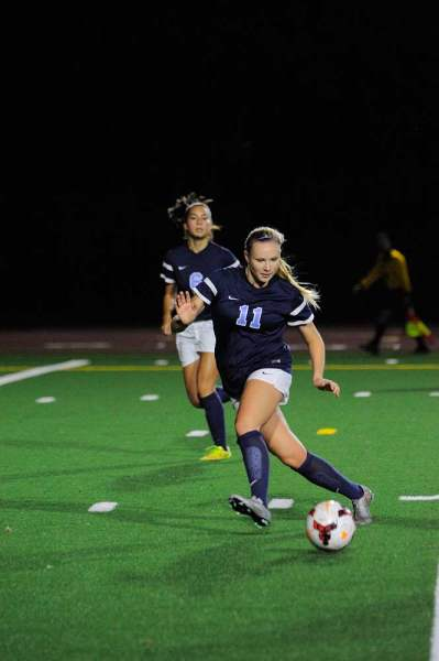 Meadowdale's Molly Todd closes in on the ball.