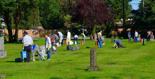 Church members at work across the cemetery grounds.