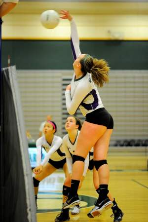 Edmonds-Woodway Maddie Tudor pounds the ball.