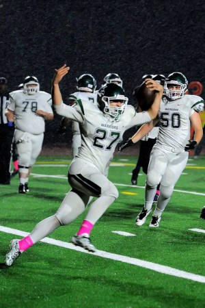 Edmonds-Woodway's Tyler Rheinford celebrates scoring a touchdown during the Warriors' 41-1 victory over Lynnwood Friday night at Edmonds Stadium. (Photos by Karl Swenson)