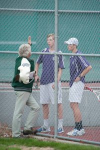 Teer and Rettenmeier confer with coach Dan Crist between sets.