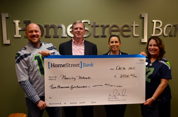 Home Street Bank in Mountlake Terrace presented a check for $2,500 Friday to the Foundation for Edmonds School District to help fund its Nourishing Network program, which provides weekend meals for low-income and homeless students. Pictured, from left, are Home Street Bank Mortgage Manager Mikhail Burdeen, Foundation Board Member Troy Rector, Foundation Executive Director Deb Anderson and Home Street Vice President and Branch Manager Marilla Sargent.