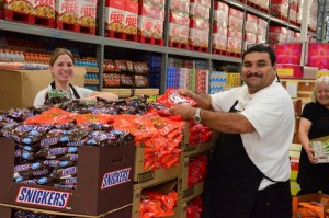 WinCo employees Breyden Icenhour and David Lopez prepare displays of Halloween candy.