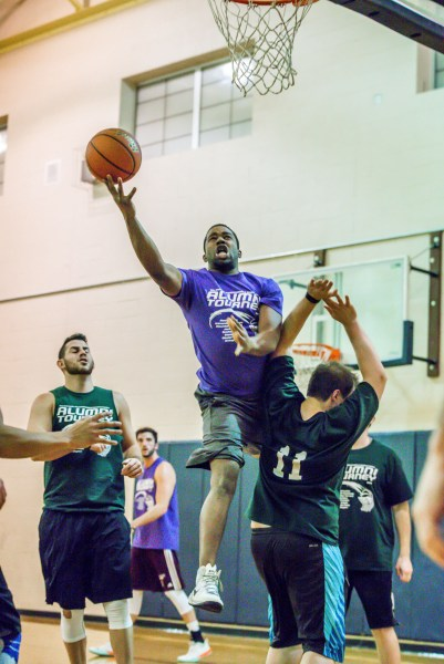 Edmonds-Woodway 2009-2014's Alex Haggard (2009) drives strong to the hoop against Jackson