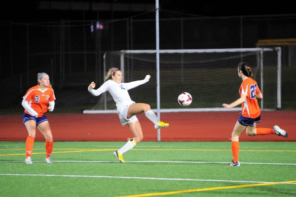 Gabby Clark scoring one of her two goals Tuesday night. (Photos by Karl Swenson)