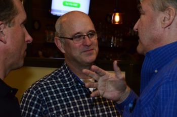Neil Tibbott, who is leading incumbent Lora Petso, speaks with supporters Tuesday night.