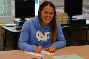 Maddy Schultz signs her letter of intent to play soccer for the University of North Carolina Tar Heels. (Photos by Larry Vogel)