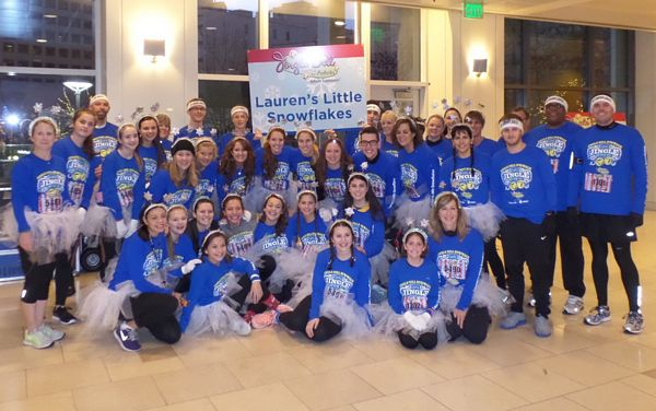 A group shot of Lauren's Little Snowflakes at the 2014 Jingle Bell Run. The team raised more than $8,000 in pledges and to help find a cure for Arthritis.