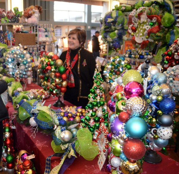 EWHS teacher Bridget Mahoney-Fernandes is surrounded by her wreath creations. You can find her work at Five and Dime Designs.