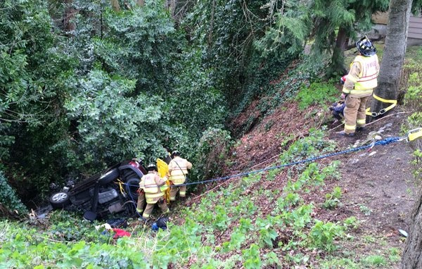 Snohomish County Fire District 1 crews were called to the 400 block of Howell Way to rescue a woman from her vehicle after it went over this embankment near the MS Helping Hands office at about 2:15 p.m. Sunday. According to Fire District 1 spokeswoman Leslie Hynes, it took about 45 minutes to get the victim out of the car. Her age and place of residence were not immediately known. The woman was taken to Swedish Edmonds with minor injuries, Hines said. (Photo courtesy Fire District 1)